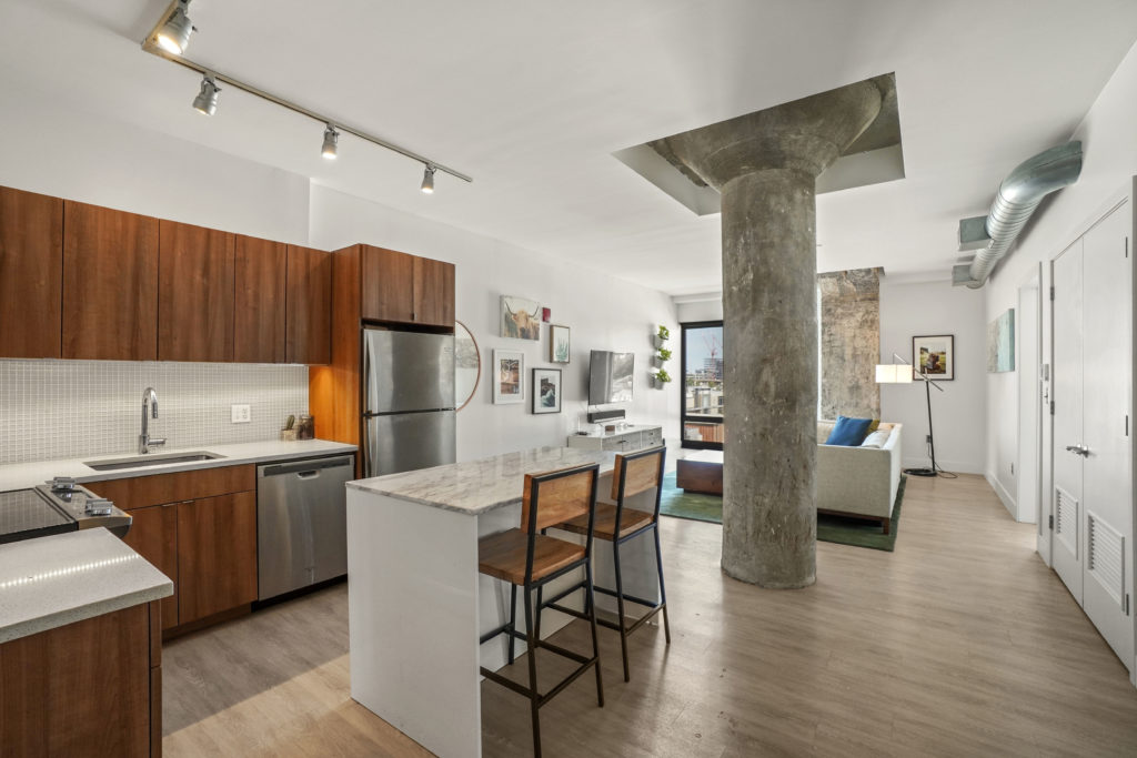 Beautiful kitchen with ceilings and a column