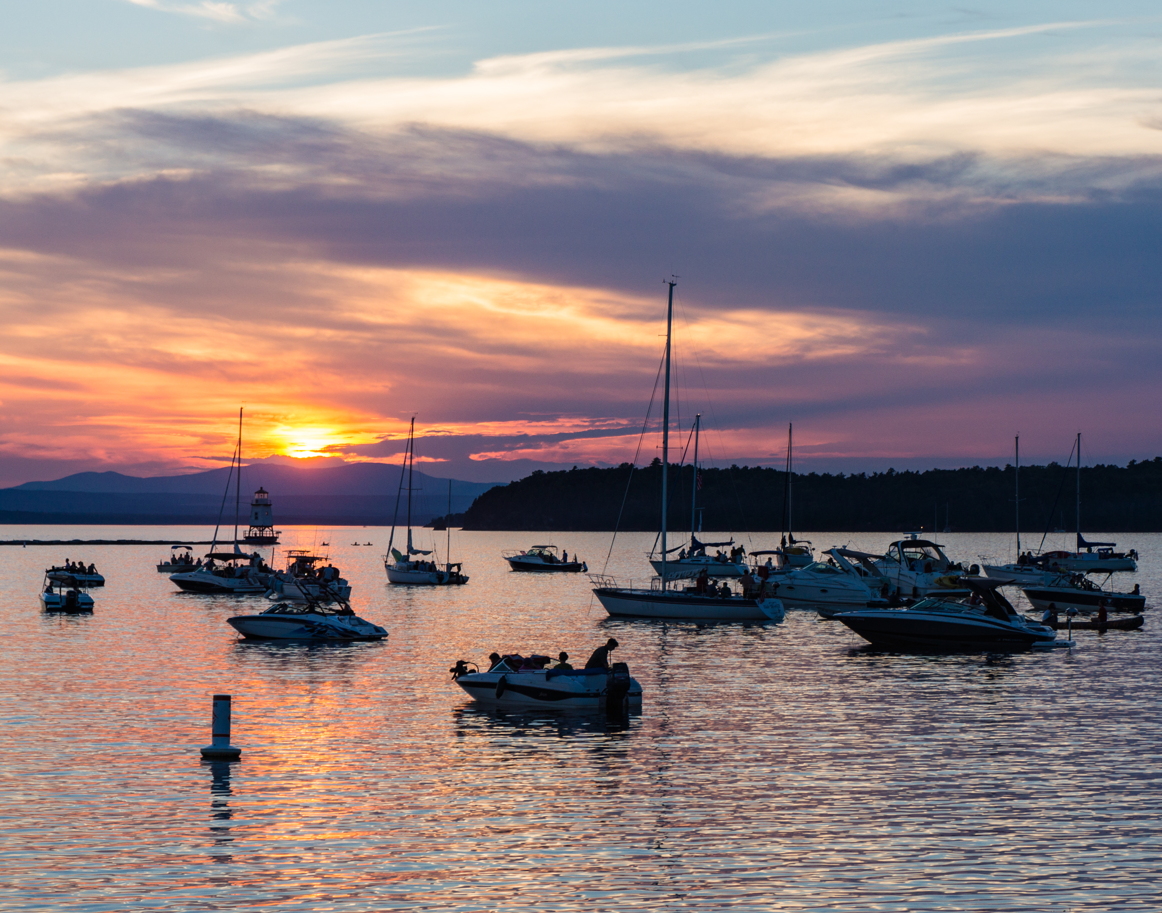 Boaters watching the sunset on Lake Champlain