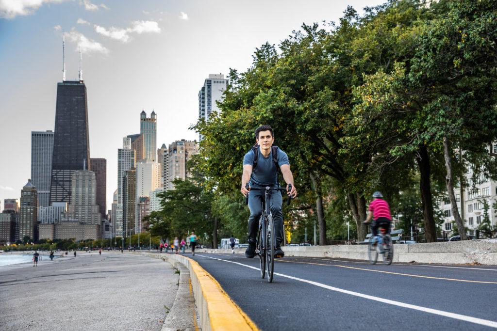 Man biking in Chicago by Michigan lak