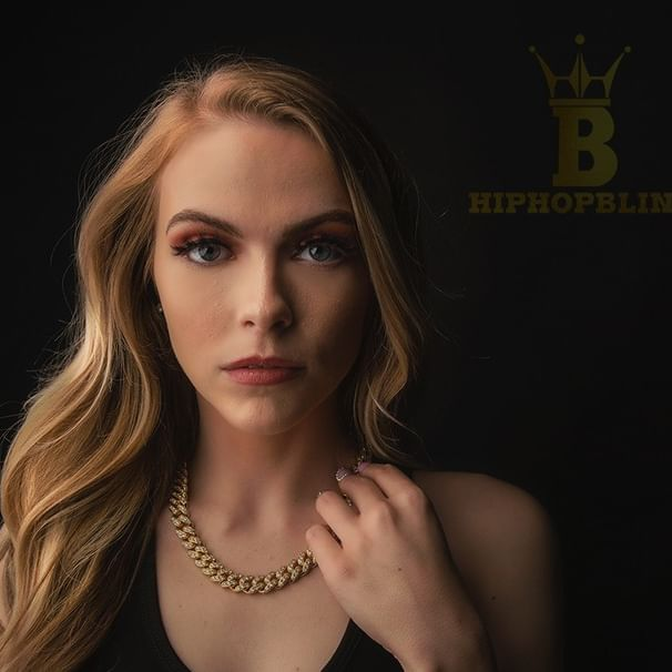 Beautiful women and stunning iced out chains, get yours at HipHopBling.com