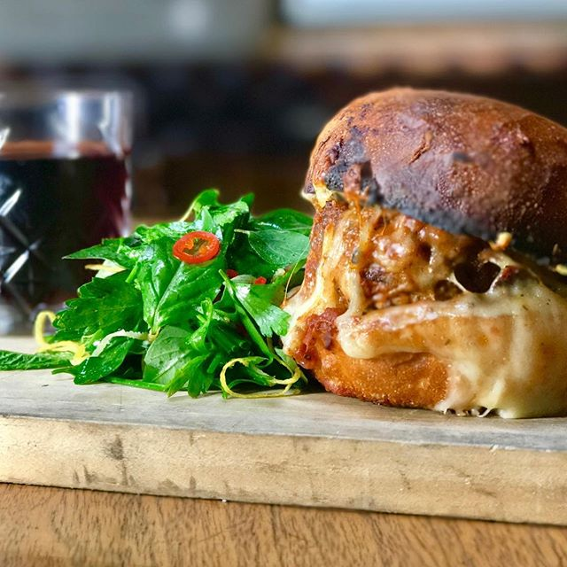 The Dirty Burger Parm, only available at Antique Bar and Bakery!