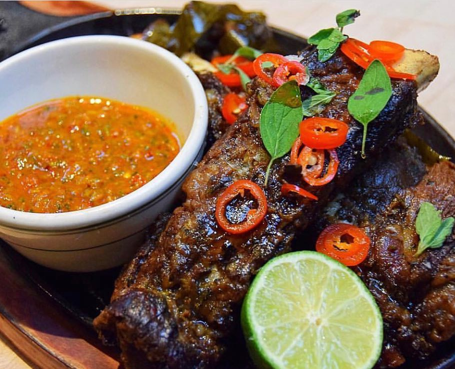 Meaty marinated back ribs served with Red Pesto - Chef Paul Gerard at Antique Bar and Bakery