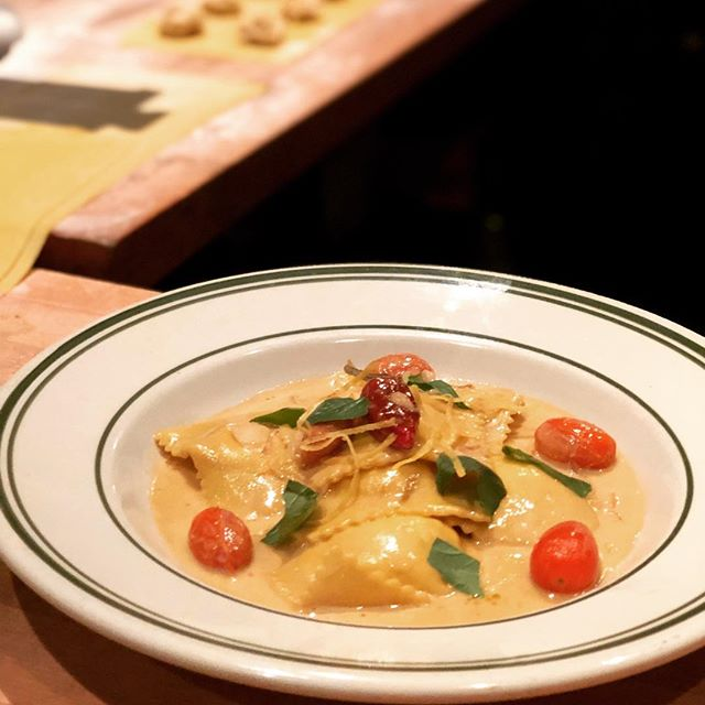 Shrimp ravioli w/ buttered shrimp reduction, herbs & chilies. Antique Bar and Bakery