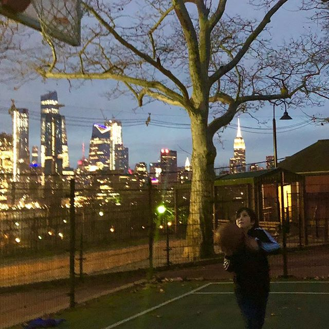 Sunset basketball with a view of the skyline