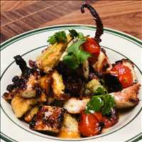 Pulpo panzanella, charred tomatoes, lime salt what more could you want? Antique Bar and Bakery folks