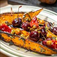 Sweet potato, pickled cherries and nuts, we always keep it fresh at Antique Bar and Bakery
