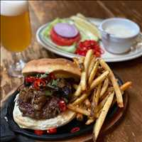 Take a look at this beautiful Antique Burger! Simple deliciousness at Antique Bar and Bakery!