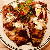 Meatball pizza on Antique bread, what more could you really want?? - Antique Bar and Bakery
