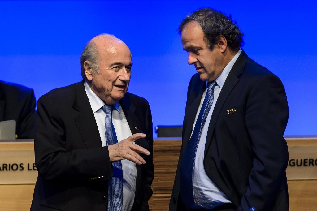 Sepp Blatter (L) and French football legend Michel Platini (R)