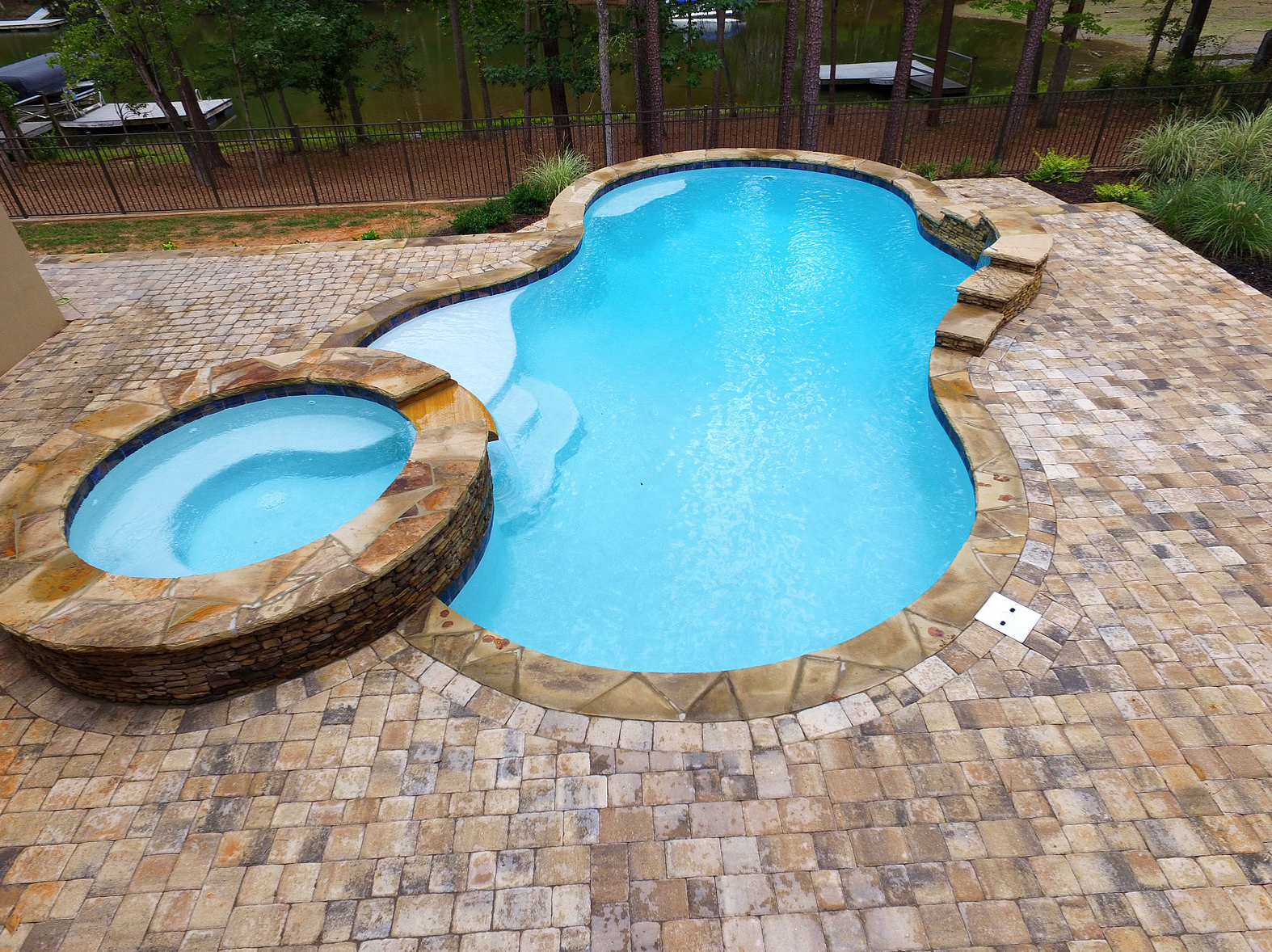 Superior pool builders carolina pool consultants discuss - Concrete swimming pools vs fiberglass ...