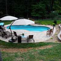 Iron Station NC Luxury Custom Inground Concrete Pools from Carolina Pool Consultants - 704-799-5236