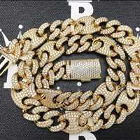 Pure drip on that gold iced out cuban link chain from Hip Hop Bling