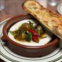 Fresh pulled mozzarella, charred green plums, all the goods at Antique Bar and Bakery