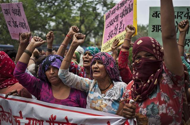 Indian Dalit women shout slogans during a protest in New Delhi