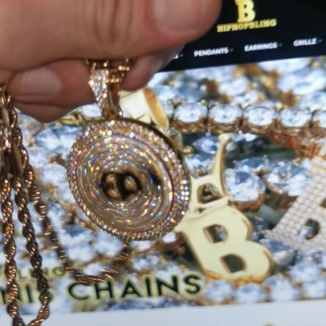 Spinning pendant, iced out and fresh gold, get some at Hip HopmBling