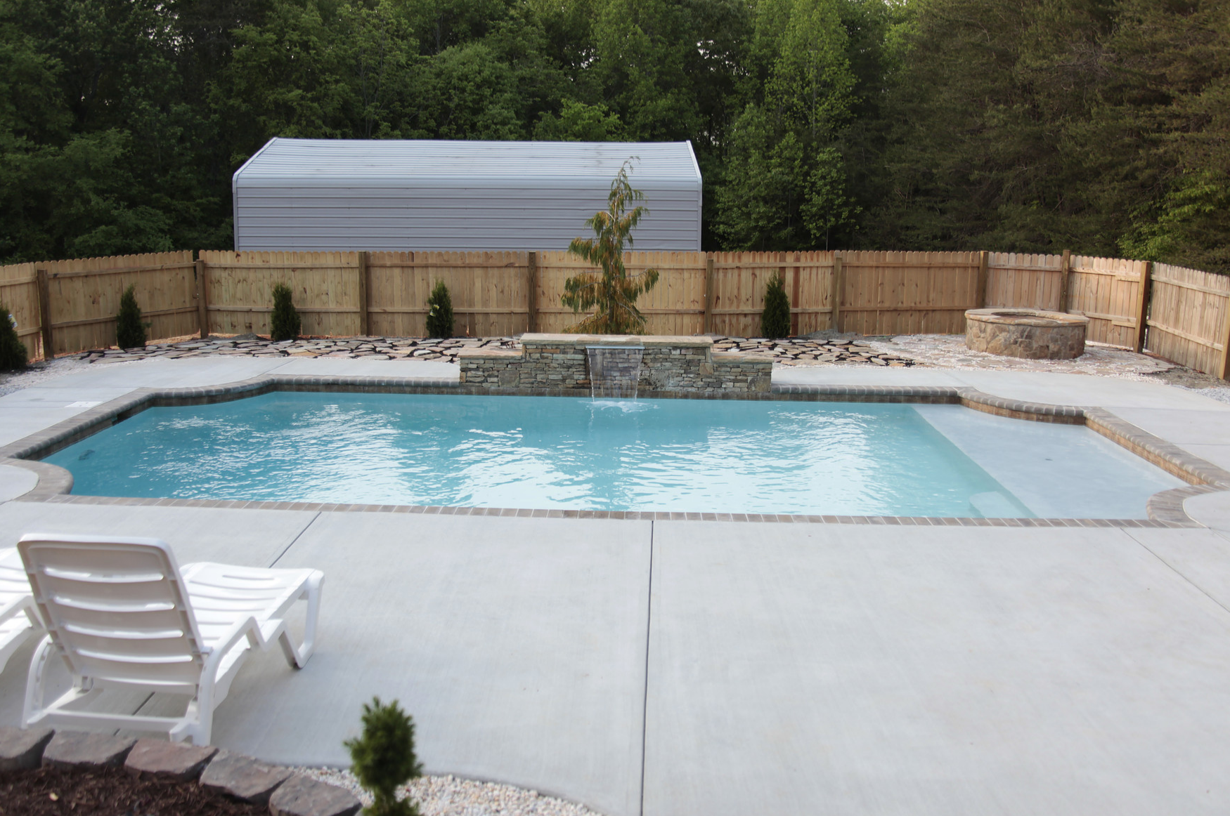 Fiberglass swimming pools vs concrete swimming pools which for Concrete swimming pool