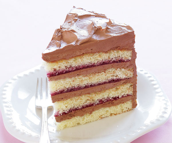 Icing A Layer Cake With Jam Filling