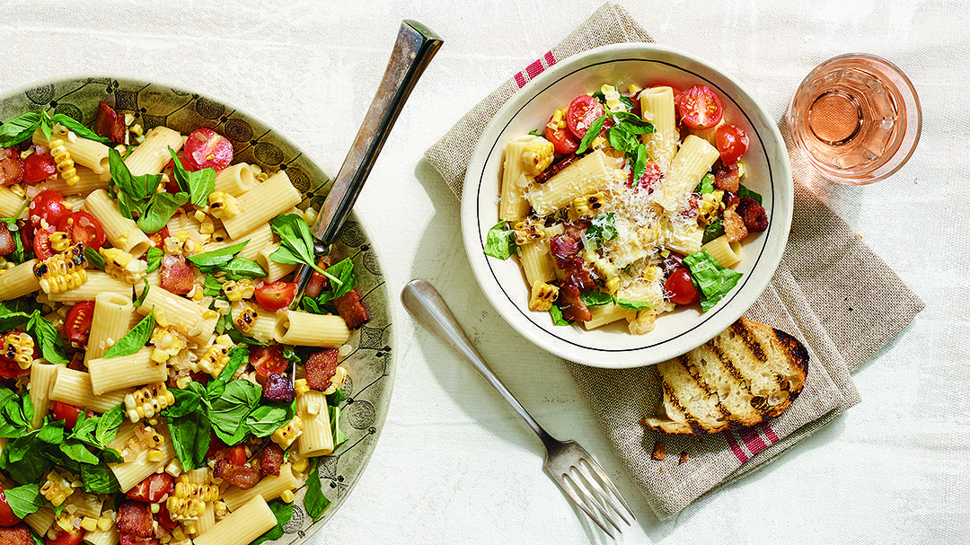 Rigatoni with Charred Corn, Sweet Onions, Cherry Tomatoes, and Bacon