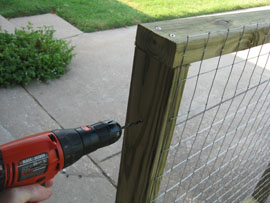 drilling hole into wooden frame
