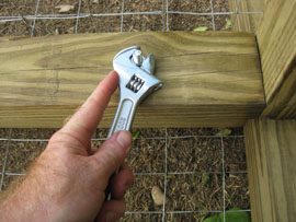 using bolts to secure parts of a compost bin