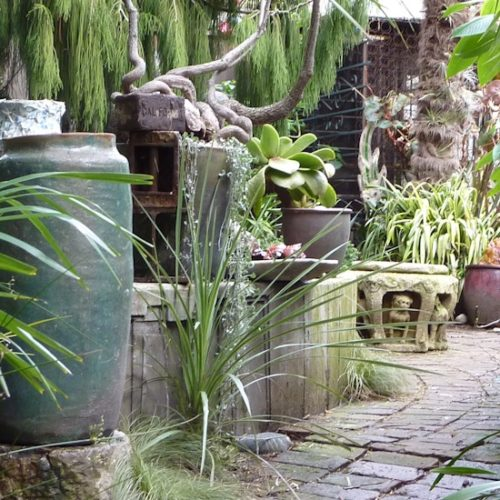 maybe im still under the spell of this little wonderland but even this oddly assembled collection of pots urns tables and bricks has a fun filled touch - Garden Definition