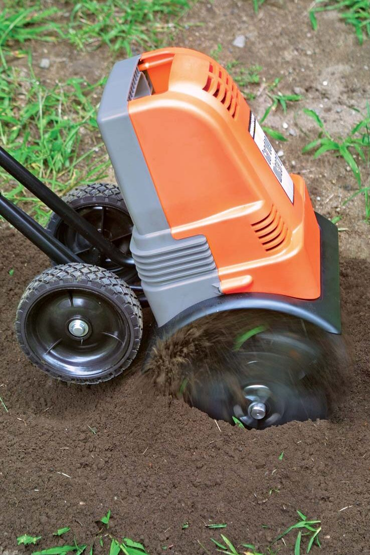 using a tilling machine to remove grass
