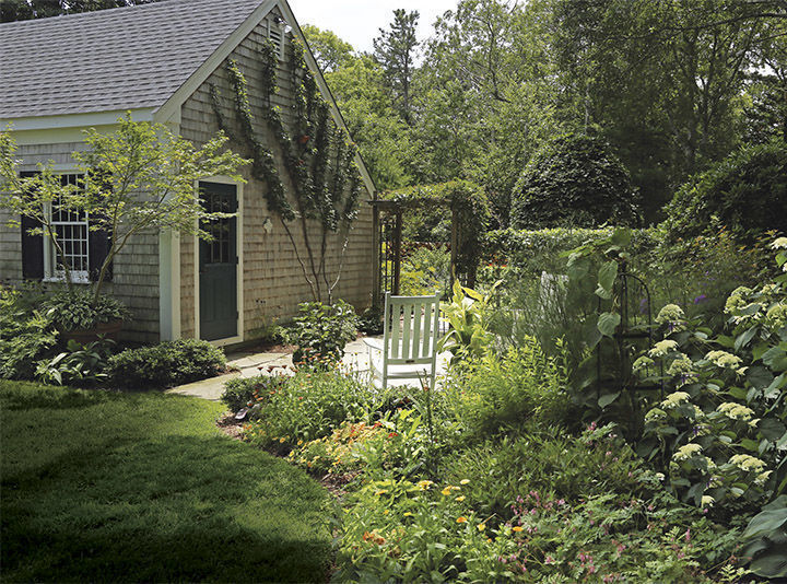 this patio takes advantage of unused space to help a small garden feel larger