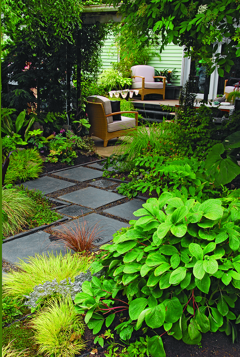 Image 2: Square Pavers Zigzag Through A Leafy Shade Garden To Meet A Back  Porch (from LITW, Page 118) Photo/Illustration: Allan Mandell