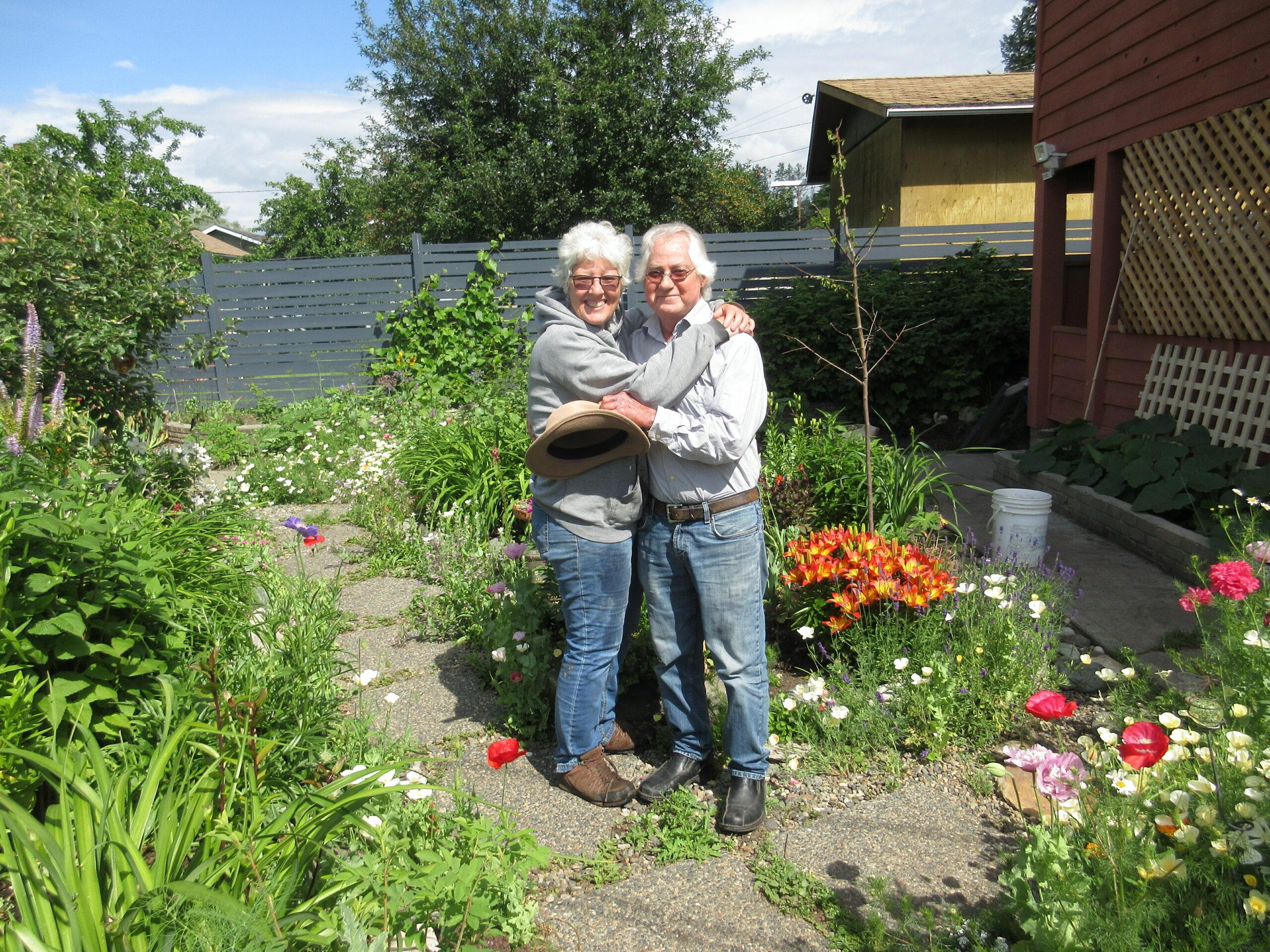 gardeners posing in her garden