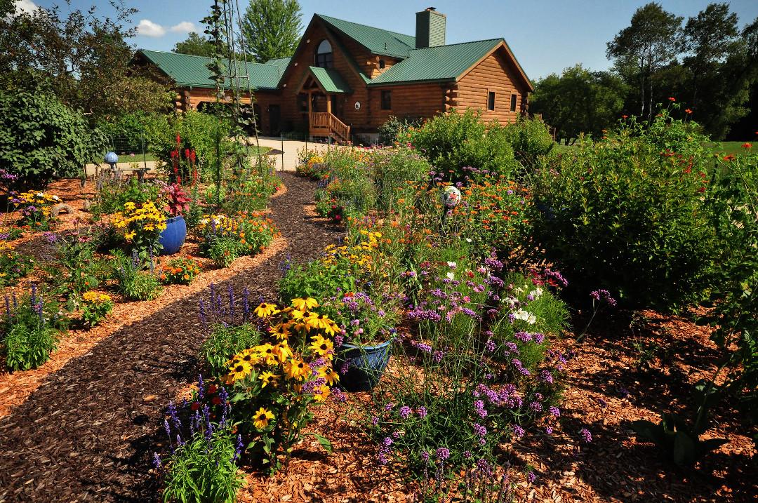 log cabin with flower garden