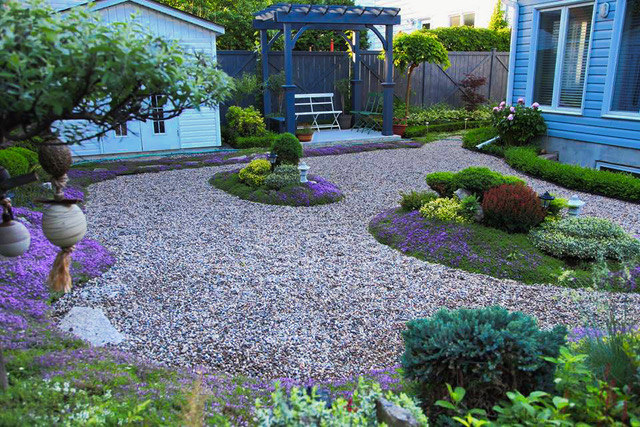 wide view of the garden with gravel paths