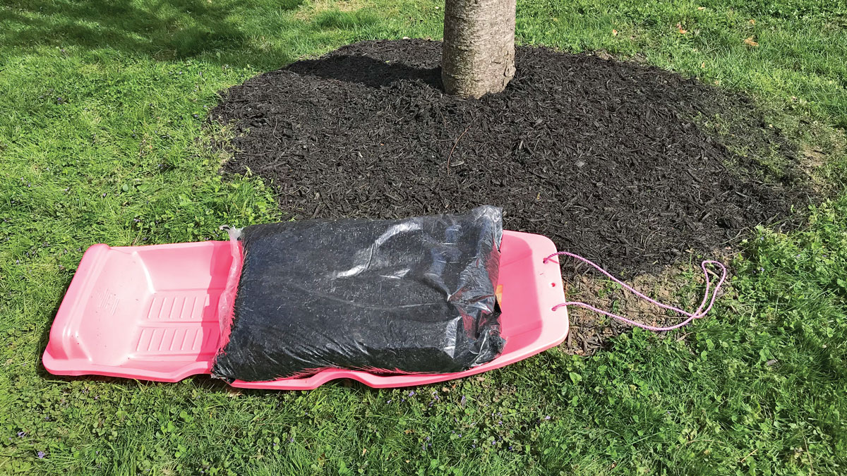 Move mulch with a sled