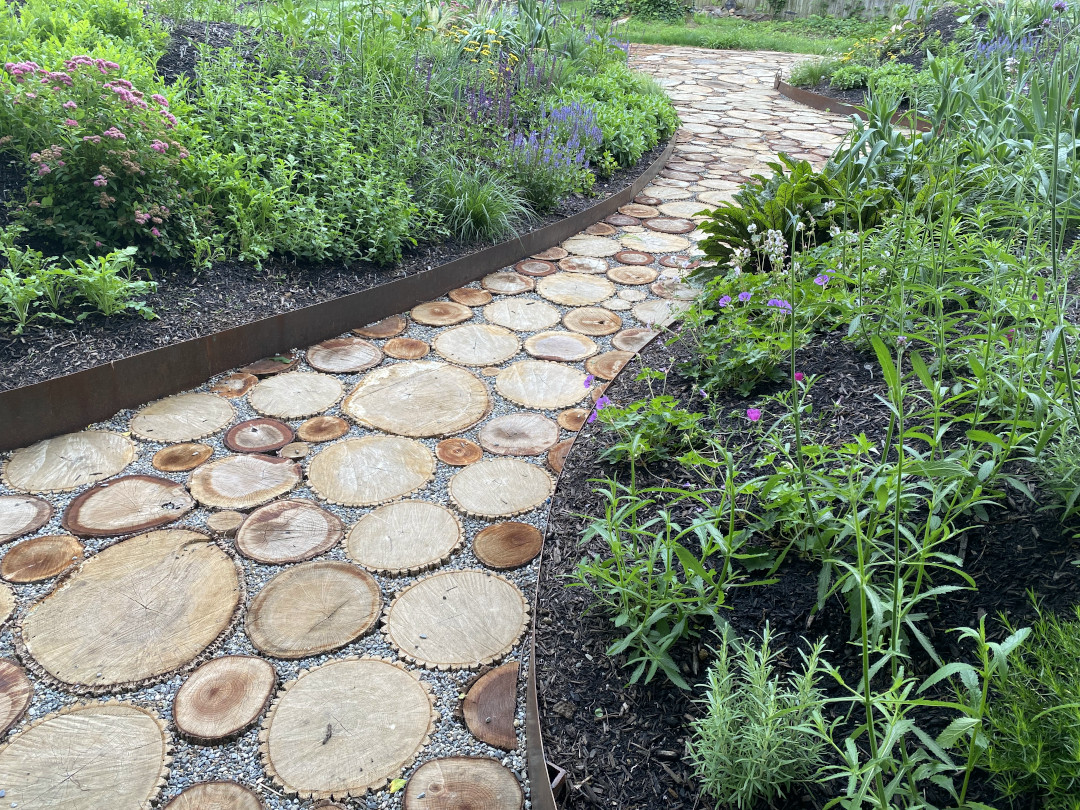 Looking down a path between two mounded garden beds