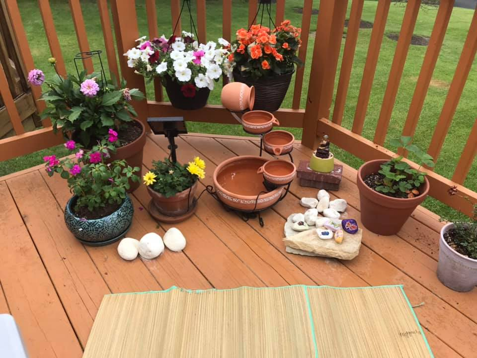 potted plants on a deck with small water feature