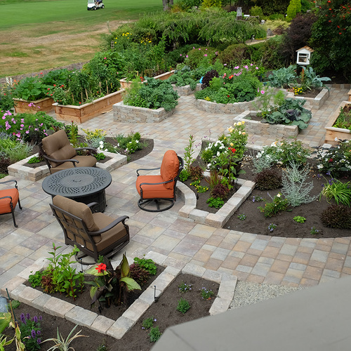 symmetrical garden patio with built in garden beds
