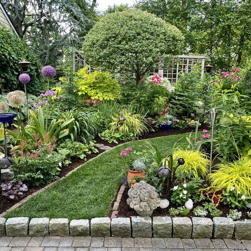 path leading between two garden beds full of golden plants