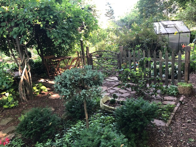 garden with rustic fence and gate
