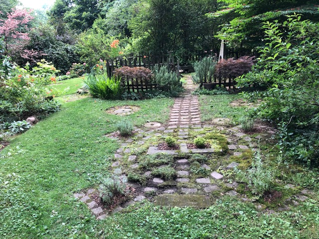 garden path leading to fenced in area