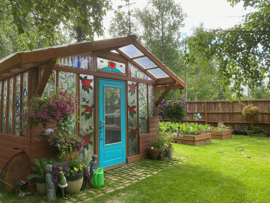 greenhouse next to two raised beds