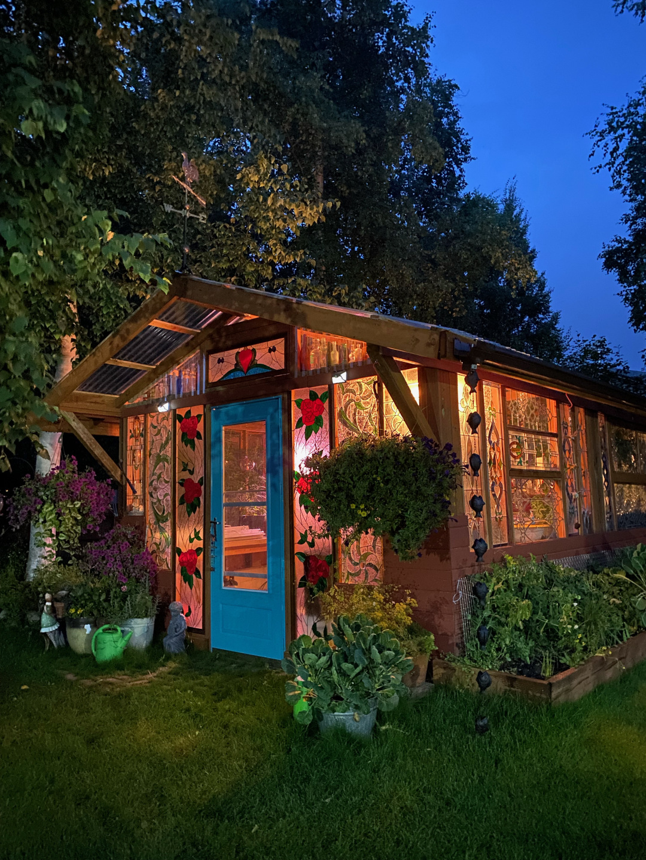 greenhouse lit up at night