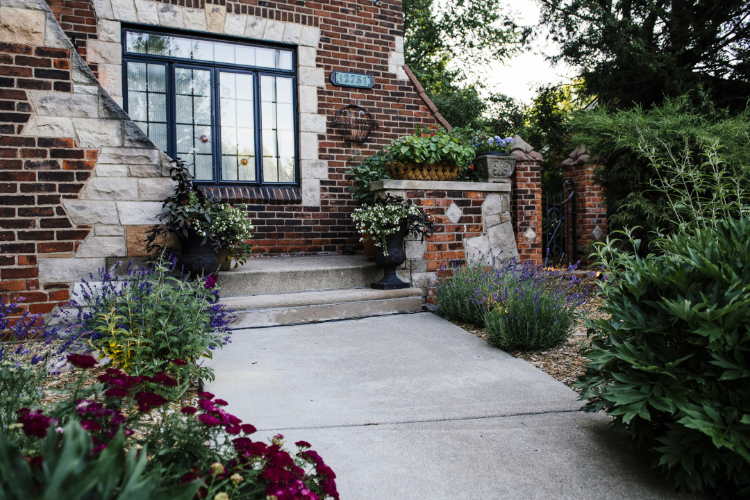 path to front door lined with plants