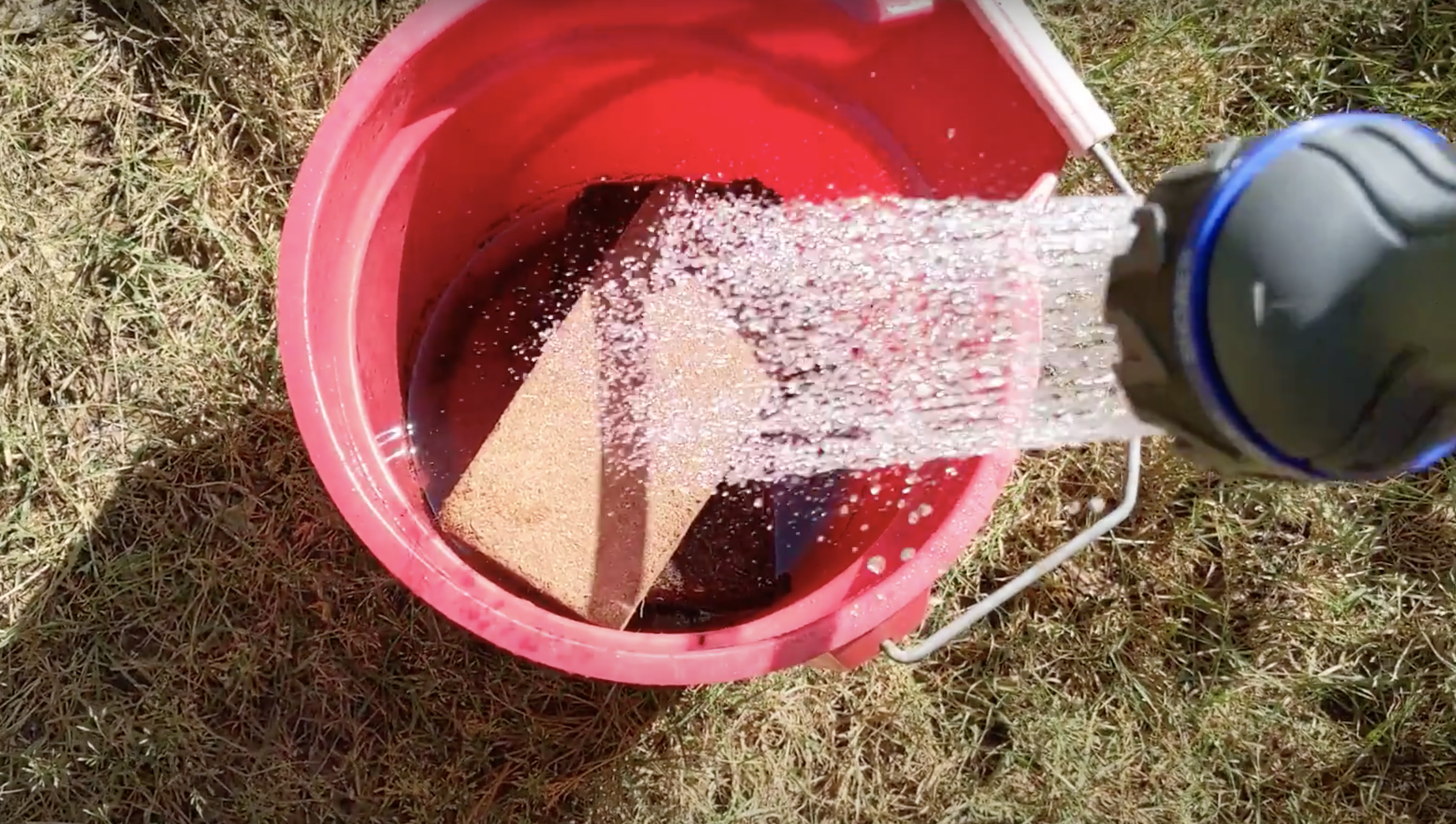 hydrating coconut coir bricks in a bucket