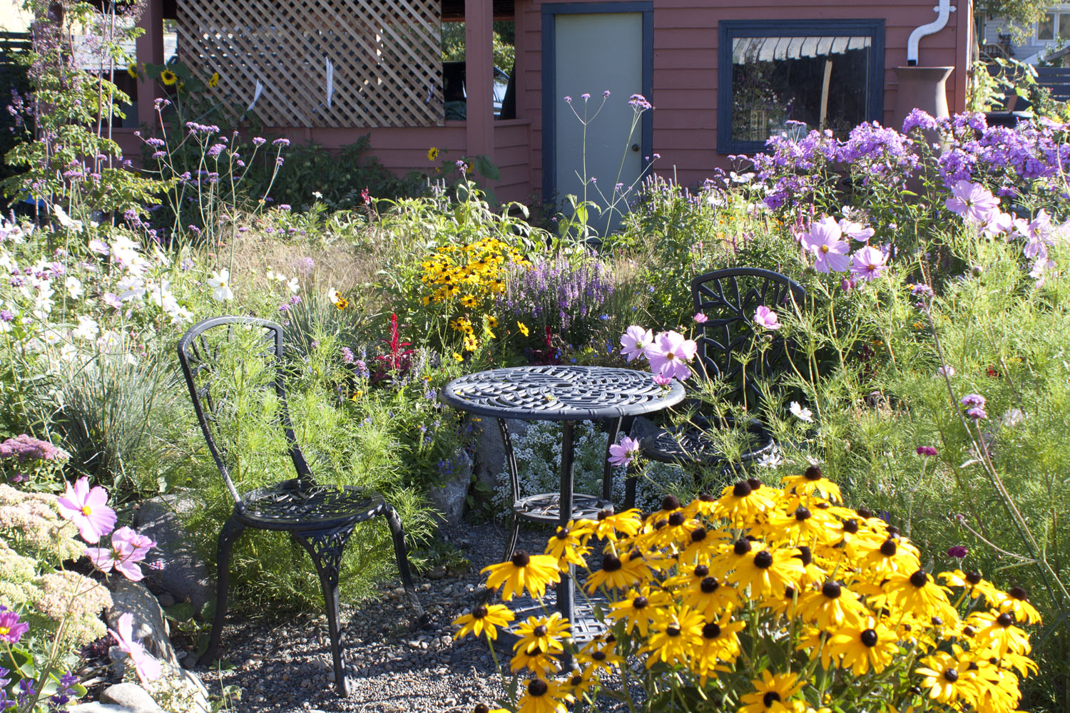 late summer flowers around a small table and chairs