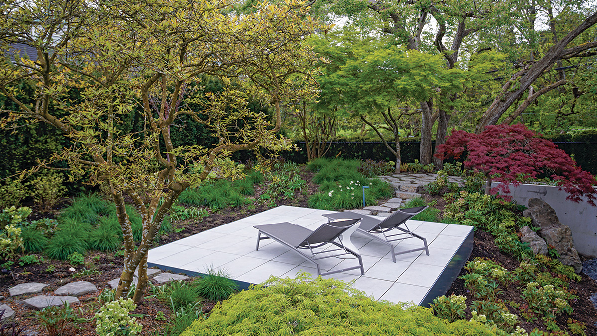 small garden patio with lounge chairs