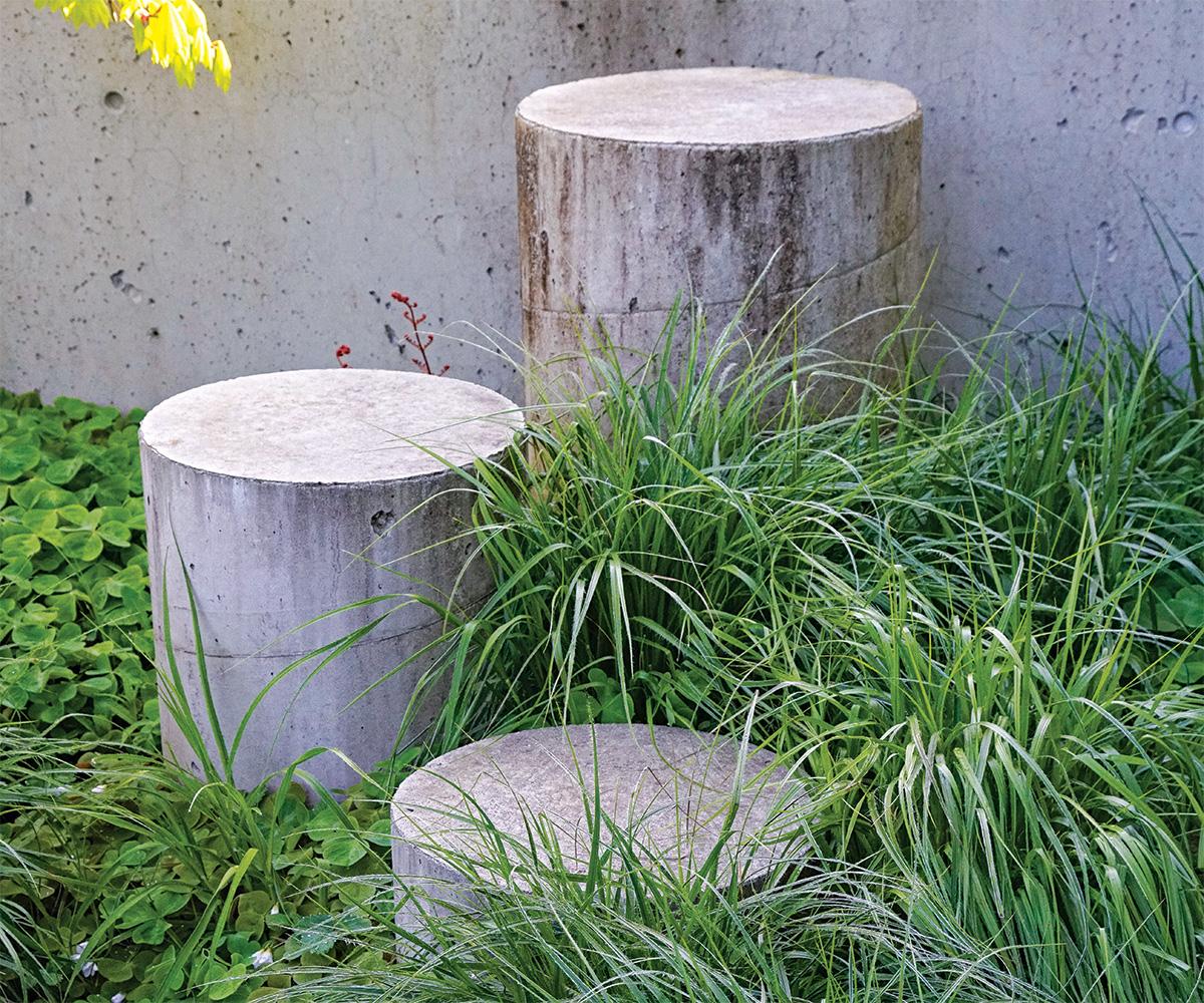 concrete rounds next to grass