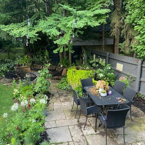 small garden patio with black table set