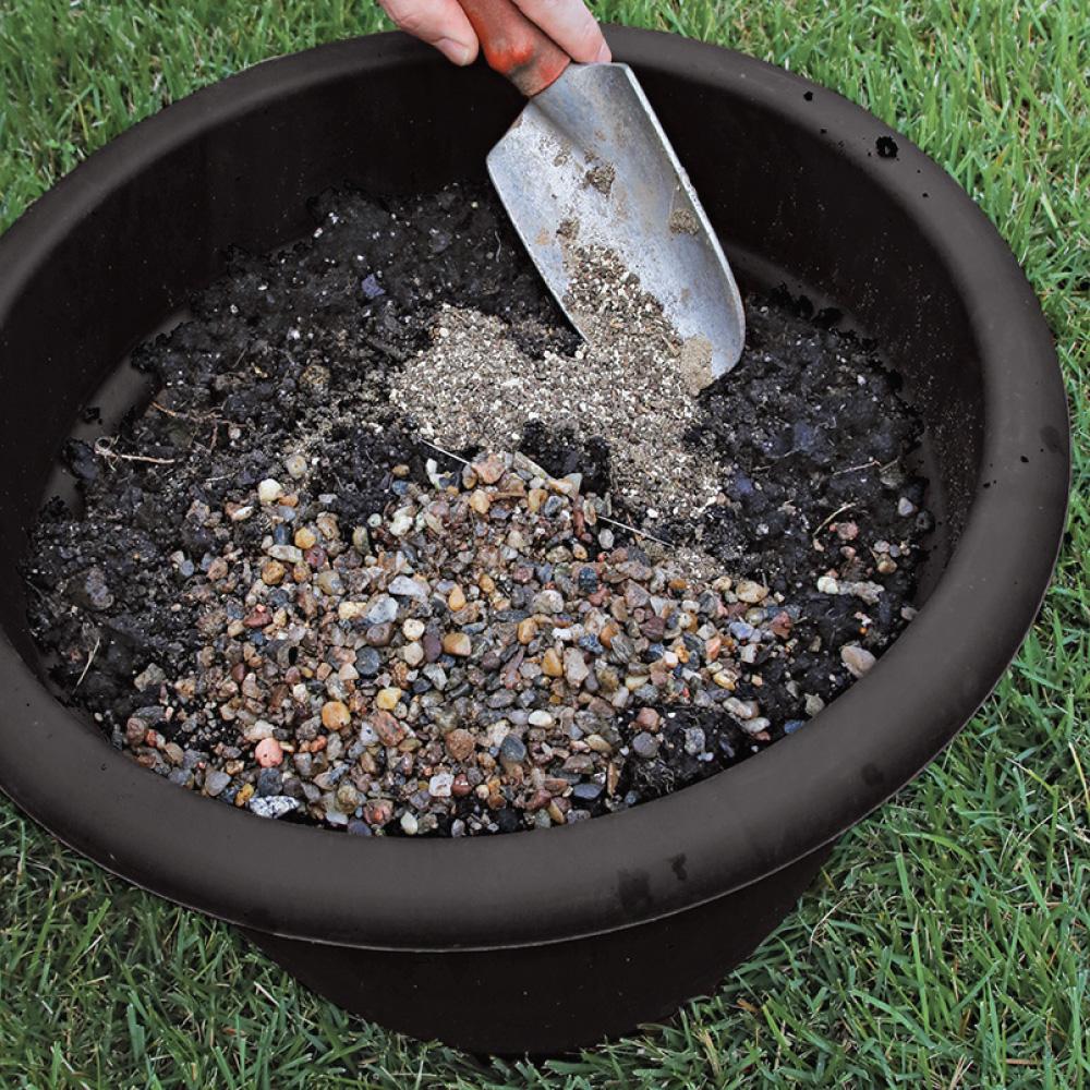 mixing gravel and fertilizer into potting soil