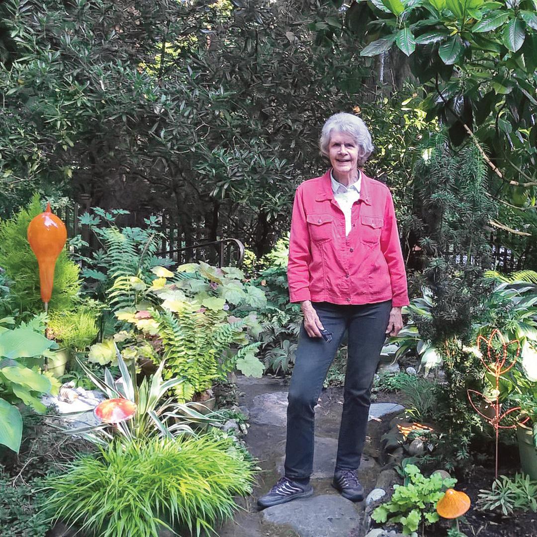 reader in her shade garden