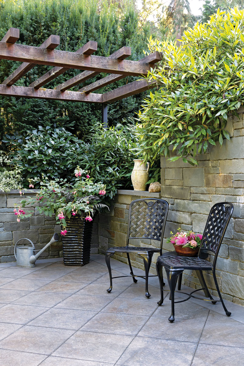 two chairs, flowering pot, and garden