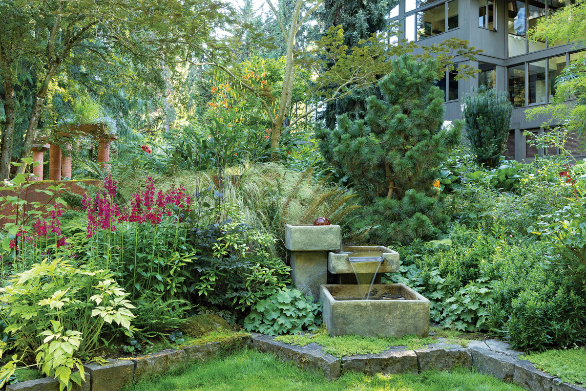 You don't have to be big to impress. A medium-size water feature helps turn a beautiful planting into a magical scene. The feature's geometric shape helps it catch the eye, but its subdued, earthy colors make it feel like an integral part of the garden.